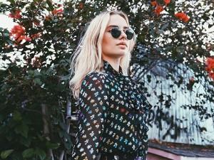 Model wearing round sunglasses