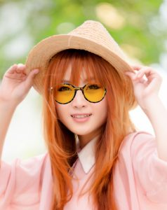 Woman wearting tinted round glasses