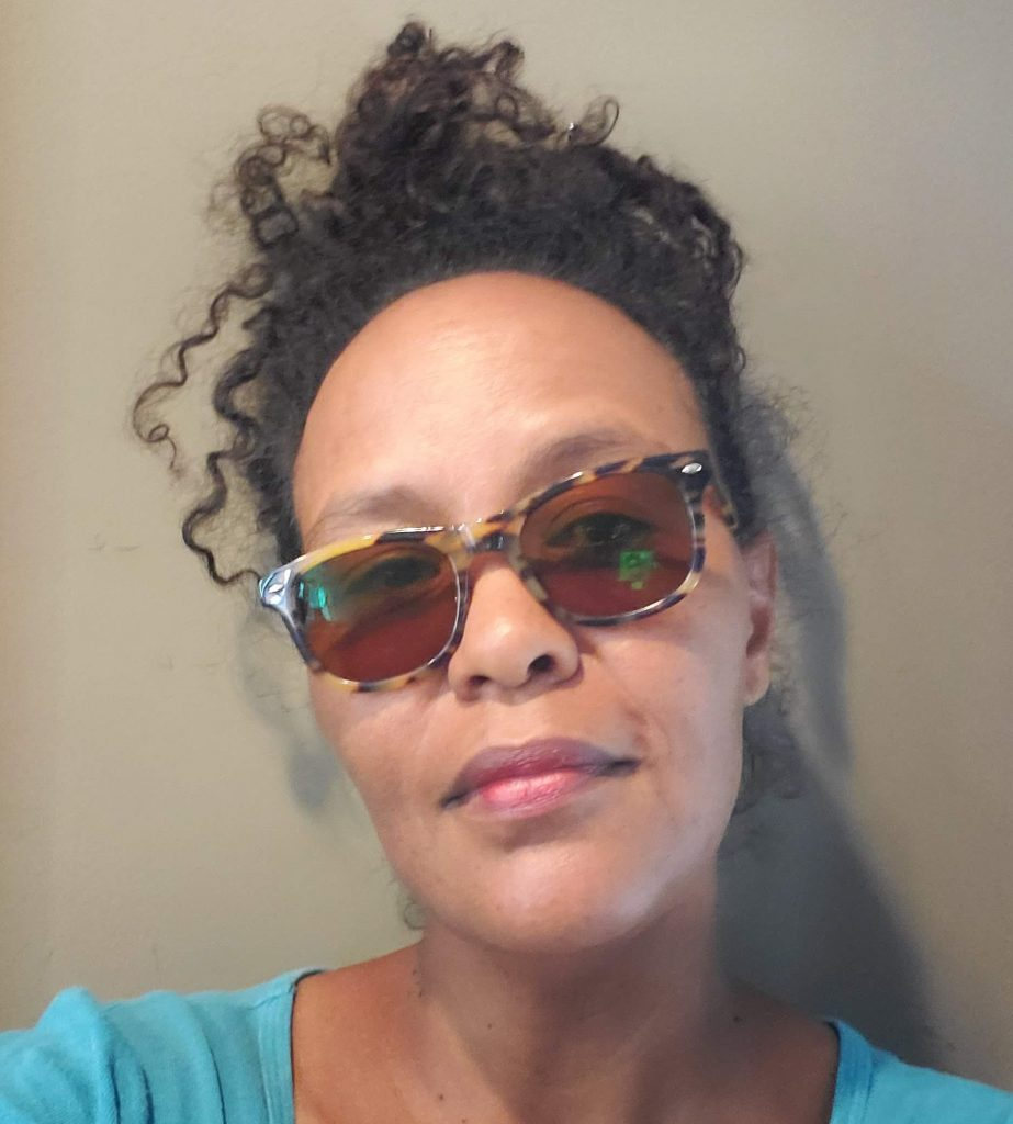 woman wearing wayfarer glasses